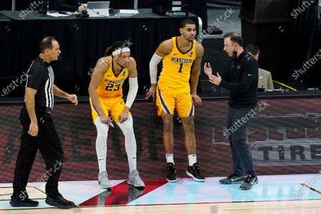 Minnesota head coach Richard Pitino talks with Tre' Williams (1) and Brandon Johnson (23) during the first half of an NCAA college basketball game against Northwestern at the Big Ten Conference tournament, in Indianapolis