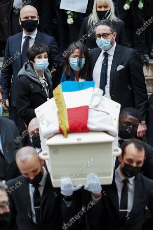 Stock Picture of Marie-Claude Pietragalla (L), Wife choreographer Leila Da Rocha (C) and a guest (R) attend Patrick Dupond's funeral at Saint-Roch Church