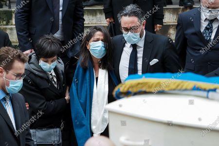 Marie-Claude Pietragalla (L), Wife choreographer Leila Da Rocha (C) and a guest (R) attend Patrick Dupond's funeral at Saint-Roch Church
