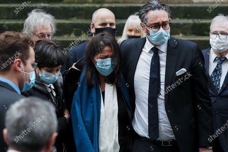 Stock Image of Marie-Claude Pietragalla (L), Wife choreographer Leila Da Rocha (C) and a guest (R) attend Patrick Dupond's funeral at Saint-Roch Church