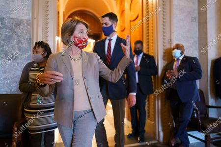 Sen. Shelley Moore Capito, R-W.Va., and Sen. Tom Cotton, R-Ark., leave the Senate chamber following procedural votes on the nomination of Xavier Becerra, President Joe Biden's pick to be secretary of Health and Human Services, and Deb Haaland to run the Interior Department, at the Capitol in Washington