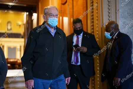 Sen. Chuck Grassley, R-Iowa, leaves the Senate chamber following a procedural vote on the nomination of Xavier Becerra, President Joe Biden's pick to be Secretary of Health and Human Services, at the Capitol in Washington