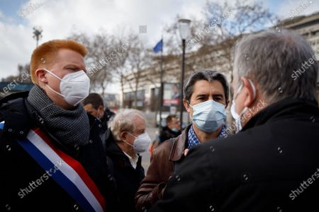 Francois Ruffin and Adrien Quatennens (deputies of France insoumise) during a rally of the staff of the pharmaceutical company Sanofi in front of the Ministry of Economy and Finance in Paris, March 11, 2021. The rally was called by unions (CGT, SUD) and political parties to protest against the company's social policy and to demand the abolition of the patents on vaccines against COVID-19.