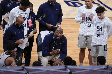 Georgetown head coach Patrick Ewing talks to his team during the second half of an NCAA college basketball game against Marquette in the Big East conference tournament, in New York