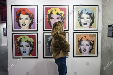 """A woman watching the """"Kate Moss"""" graphics by Banksy during the exhibition. At the Koneser Centrum Praskie gallery """"The Art of Banksy. Without limits"""" exhibition is the first in Poland as a large presentation of the works of this mysterious artist. It presents over 100 works, original exhibits but also works in the form of photographs, sculptures and many others. Moreover, some of the exhibits are reconstructed using his own technique - templates created especially for this exhibition. AS most of Banksy's exhibition this one is also not authorized by the artist."""