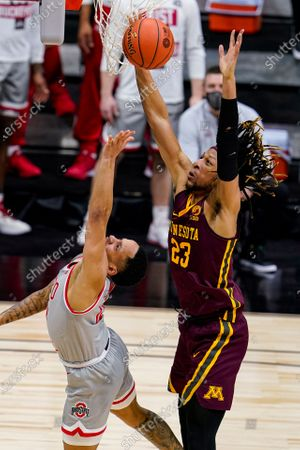 Minnesota forward Brandon Johnson (23) grabs a rebound over Ohio State guard CJ Walker (13) in the second half of an NCAA college basketball game at the Big Ten Conference tournament in Indianapolis