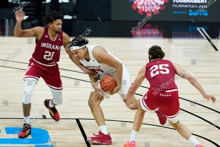 Rutgers' Ron Harper Jr. (24) goes to the basket against Indiana's Jerome Hunter (21) and Race Thompson (25) during the second half of an NCAA college basketball game at the Big Ten Conference tournament, in Indianapolis
