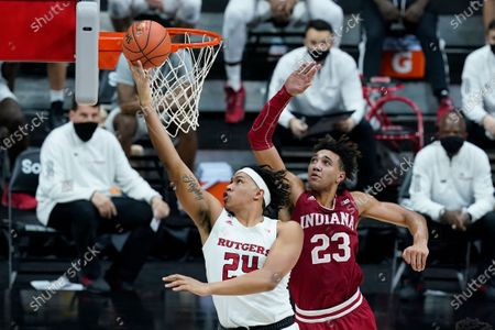 Rutgers' Ron Harper Jr. (24) puts up a shot against Indiana's Trayce Jackson-Davis (23) during the second half of an NCAA college basketball game at the Big Ten Conference tournament, in Indianapolis