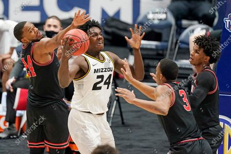Stock Image of Missouri's Kobe Brown (24) tries to control the ball as he is defended by Georgia's P.J. Horne (24) and Christian Brown (3) in the first half of an NCAA college basketball game in the Southeastern Conference Tournament, in Nashville, Tenn