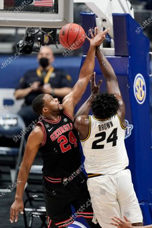 Stock Picture of Missouri's Kobe Brown, right, drives against Georgia's P.J. Horne, left, in the first half of an NCAA college basketball game in the Southeastern Conference Tournament, in Nashville, Tenn