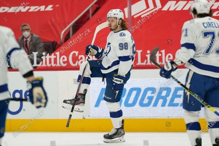 Tampa Bay Lightning defenseman Mikhail Sergachev (98) celebrates his goal against the Detroit Red Wings in the first period of an NHL hockey game, in Detroit