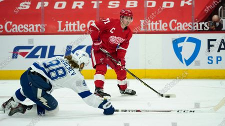 Tampa Bay Lightning defenseman Mikhail Sergachev (98) defends Detroit Red Wings center Dylan Larkin (71) in the second period of an NHL hockey game, in Detroit