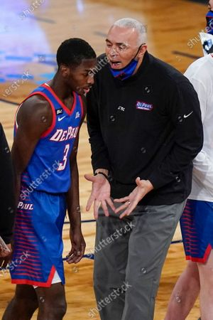 DePaul head coach Dave Leitao talks to Kobe Elvis during the first half of the team's NCAA college basketball game against Connecticut in the Big East men's tournament, in New York