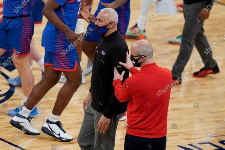 Connecticut coach Dan Hurley, right, talks to DePaul coach Dave Leitao after an NCAA college basketball game in the Big East men's tournament, in New York