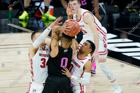 Penn State's Myreon Jones (0) is trapped by Wisconsin's Brad Davison (34) and D'Mitrik Trice (0) during the second half of an NCAA college basketball game at the Big Ten Conference tournament, in Indianapolis