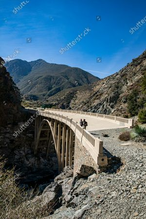 Stock Photo of Hikers Manuel Razo, right, and Daniela Osorio, left, take in the San Gabriel river canyon view on the Bridge to Nowhere on Thursday, Feb. 11, 2021 in Azusa, CA. (Brian van der Brug / Los Angeles Times)