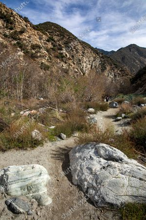 Editorial image of Large rocks and a sandy trail wind through a riparian area, Azusa, California, United States - 11 Feb 2021