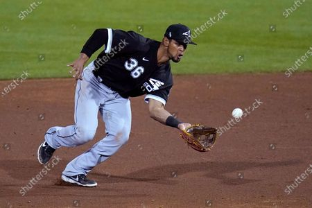 Stock Photo of Chicago White Sox second baseman Marco Hernandez reaches out to catch a grounder hit by Cincinnati Reds' Dee Strange-Gordon before throwing to first base for the out during the third inning of a spring training baseball game, in Goodyear, Ariz