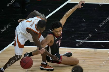 Stock Picture of Texas guard Andrew Jones (1) and Texas Tech guard Micah Peavy (5) chase a loose ball during the first half of an NCAA college basketball game in the quarterfinal round of the Big 12 men's tournament in Kansas City, Mo