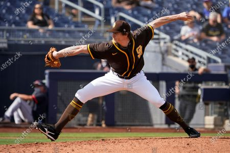 San Diego Padres' Tim Hill pitches during a spring training baseball game against the Cleveland Indians, in Peoria, Ariz