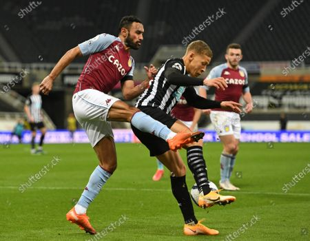 Dwight Gayle of Newcastle United fends off Ahmed Elmohamady of Aston Villa