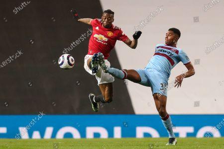Aaron Wan-Bissaka of Manchester United battles with Ben Johnson of West Ham United