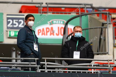 Salford City co-owner Paul Scholes looks on, right