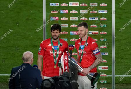 Penalty winner Jason Lowe, left, and captain Ashley Eastham of Salford City interviewed by Sky Sports after victory