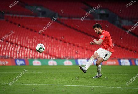 Jason Lowe of Salford City scores the winning penalty