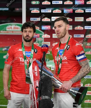 Jason Lowe, left, and Ashley Eastham of Salford City interviewed by Sky Sports after victory