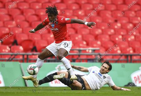 Brandon Thomas-Asante of Salford City is tackled by Charlie Daniels of Portsmouth