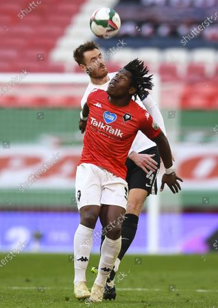 Brandon Thomas-Asante of Salford City under pressure from Jason Lowe of Salford City