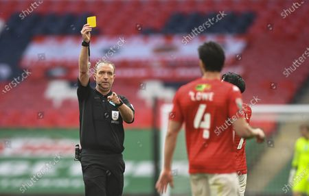 Jason Lowe of Salford City is shown a yellow card by Referee Carl Boyeson