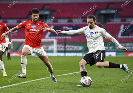Ryan Williams of Portsmouth under pressure from Jason Lowe of Salford City