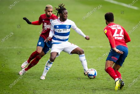 Osman Kakay of QPR with Juninho Bacuna of Huddersfield Town (l) and Fraizer Campbell of Huddersfield Town (r)