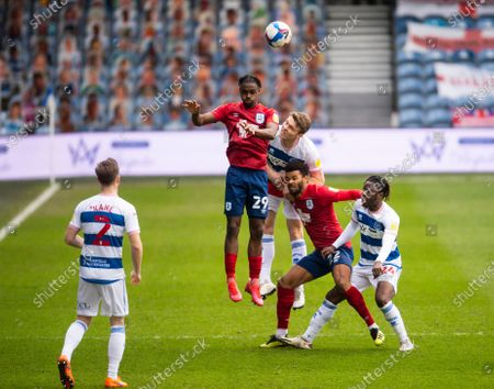 h29Aaron Rowe of Huddersfield Town and Rob Dickie of QPR jumping and Osman Kakay of QPR and Fraizer Campbell of Huddersfield Town