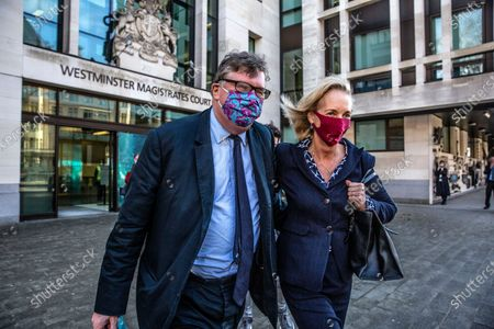 Crispin Odey investement banker aquitted of sexual assult, leaves Westminster Magistrates with wife Nichola Pease.