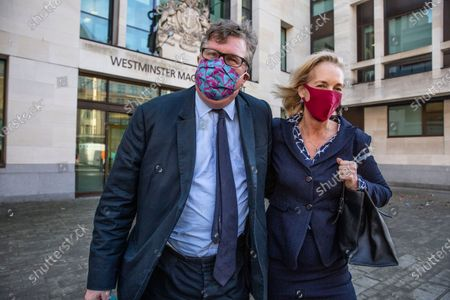 Stock Photo of Crispin Odey investement banker aquitted of sexual assult, leaves Westminster Magistrates with wife Nichola Pease.
