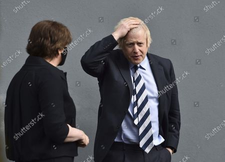 Stock Photo of Britain's Prime Minister Boris Johnson alongside First Minister Arlene Foster, leaves after a visit to the Lakeland Forum vaccination centre in Enniskillen, Northern Ireland