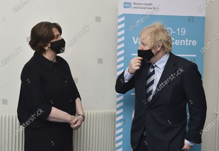 Stock Image of Britain's Prime Minister Boris Johnson speaks with First Minister Arlene Foster during a visit to the Lakeland Forum vaccination centre in Enniskillen, Northern Ireland