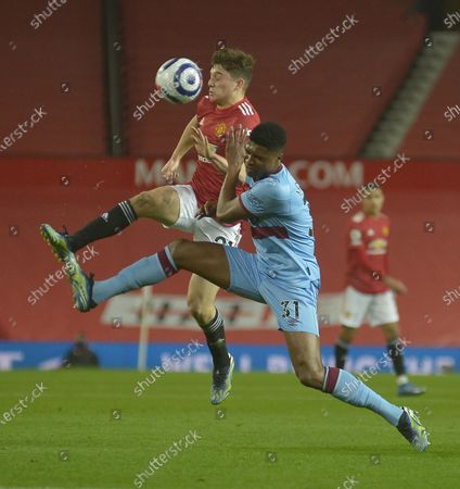 Ben Johnson of West Ham United in action with Daniel James of Manchester United