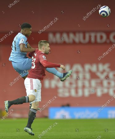Ben Johnson of West Ham United in action with Luke Shaw of Manchester United