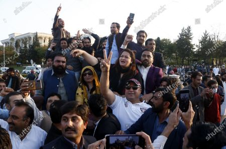 Stock Picture of Supporters of Imran Khan, head of ruling party Pakistan Tehreek-e-Insaf (PTI), celebrate outside the parliament during the Senate chairman election in Islamabad, Pakistan, 12 March 2021. The government's candidate for the Senate chairman election Sadiq Sanjrani defeated Yousaf Raza Gillani of the Opposition coalition of the Pakistan Democratic Movement (PDM).