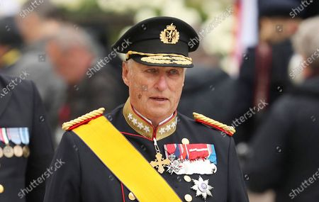 King Harald V of Norway, with his wife Sonja, leave the Notre Dame cathedral after attending the funeral of the Grand Duke Jean of Luxembourg, in Luxembourg. Norway's 84-year-old King Harald V will remain on sick leave from his ceremonial duties until April 11 after successful leg surgery earlier this year, the palace said Friday March 12, 2021