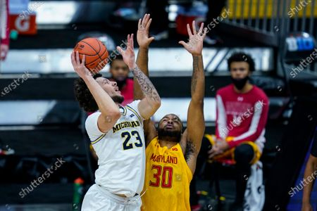 Michigan forward Brandon Johns Jr. (23) shoots over Maryland forward Galin Smith (30) in the first half of an NCAA college basketball game at the Big Ten Conference tournament in Indianapolis
