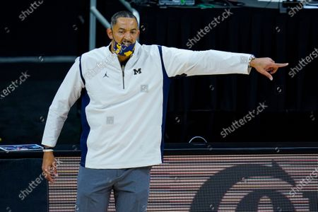 Michigan head coach Juwan Howard directs his team as they played Maryland in the first half of an NCAA college basketball game at the Big Ten Conference tournament in Indianapolis