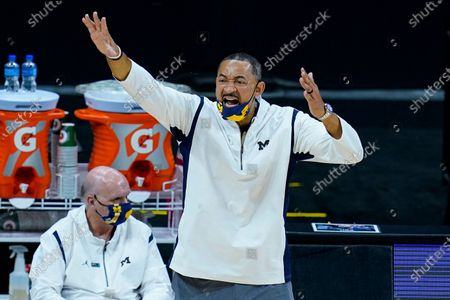 Michigan head coach Juwan Howard questions a call in the second half of an NCAA college basketball game against Maryland at the Big Ten Conference tournament in Indianapolis, . Howard was later ejected from the game