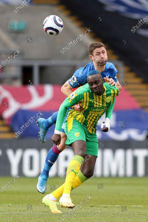 Football - 2020 /2021 Premier League - Crystal Palace vs West Bromwich Albion - Selhurst Park Mbaye Diagne of West Bromwich Albion and Gary Cahill of Crystal Palace