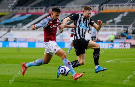 Aston Villa midfielder Mahmoud Hassan (17) and Newcastle United defender Paul Dummett (3)  during the Premier League match between Newcastle United and Aston Villa at St. James's Park, Newcastle