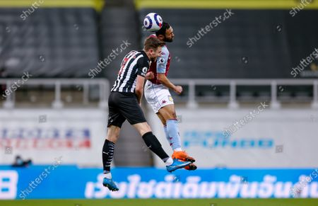 Newcastle United defender Paul Dummett (3) is beaten in the air by Aston Villa defender Ahmed Elmohamady (27)  during the Premier League match between Newcastle United and Aston Villa at St. James's Park, Newcastle